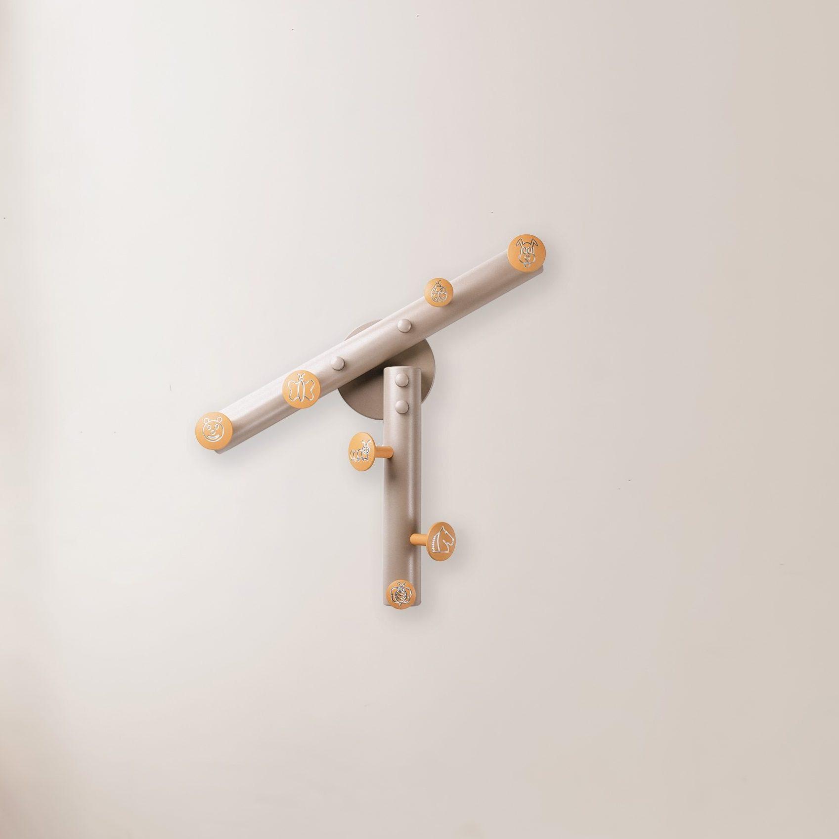 Ukuta - appendiabiti a muro in alluminio color sabbia e giallo